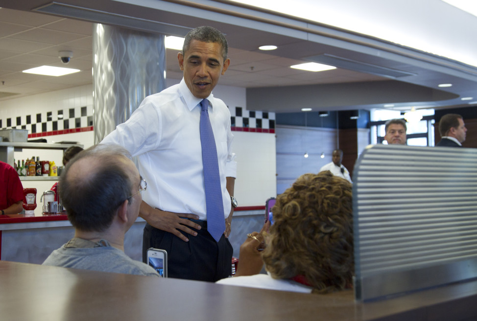 President Barack Obama greets people inside Sloopy's diner in the Ohio State Student Union, Tuesday, Aug. 21, 2012, in Columbus, Ohio.