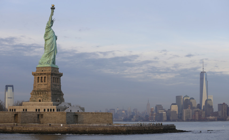 The Statue of Liberty looks out on the lower Manhattan skyline, January 2014. (AP)