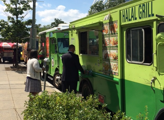 A row of mobile food trucks serve lunch near Capital Hill in Washington, D.C.