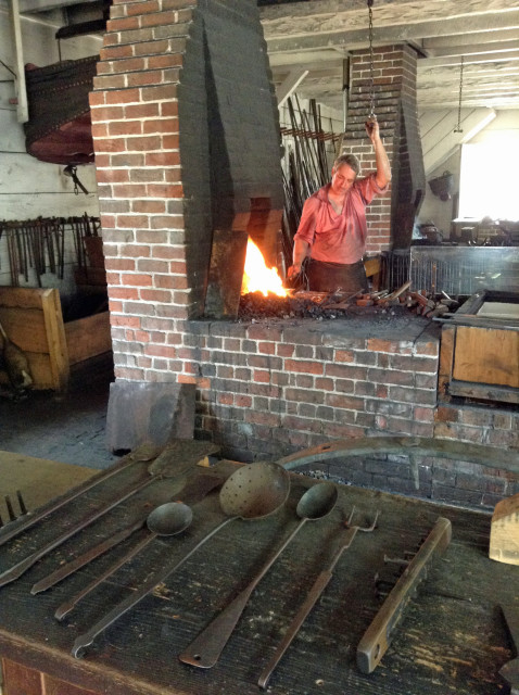 Costumed interpreters practice ancient crafts, such as blacksmithing, in much the same way they were practiced in 1700s America.
