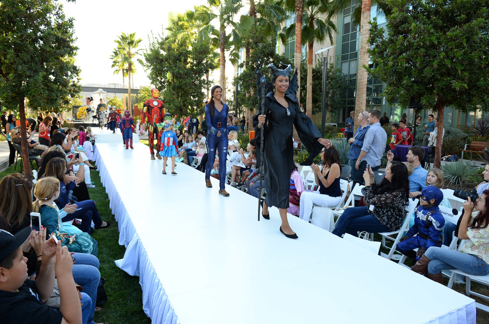 "Models in costumes from Walt Disney Studio's ""Maleficent"", Marvel's ""Avengers"" and more at a Disney Halloween Fashion Show,  Oct. 1, 2014, in Glendale, Calif. (Photo by Jordan Strauss/Invision for Disney Consumer Products/AP Images)"