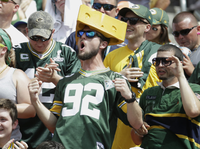 Green Bay Packers fans cheer during an NFL football game against the Miami Dolphins, Oct. 12, 2014, in Miami Gardens, Fla. (AP Photo)