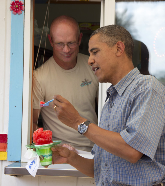President Barack Obama enjoys a snow cone while on the campaign trail, Aug. 13, 2012, in Denison, Iowa.