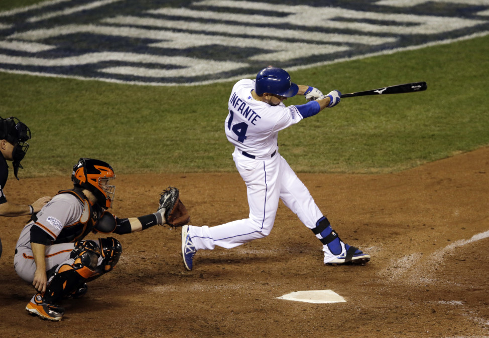 Kansas City Royals' Omar Infante hits a two-run home run during Game 2 of baseball's World Series against the San Francisco Giants , Oct. 22, 2014, in Kansas City, Mo. (AP Photo)