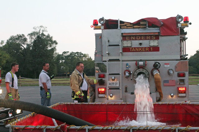Volunteer Fire Chief Harold Rohde (far right) and volunteer firefighter Jacob Coon, at a fire training exercise at the Enders Fire Company in Berryville, Virginia.