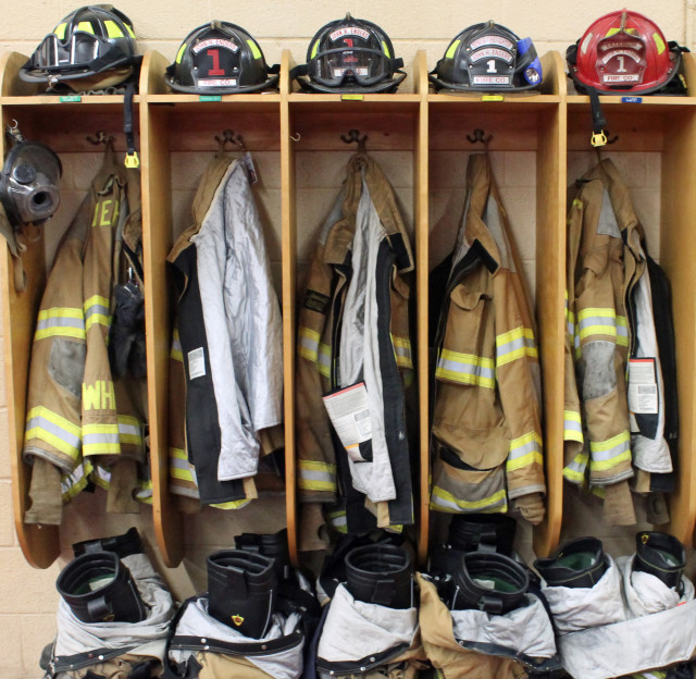 Volunteer firefighter uniforms hanging at the ready at the Enders Volunteer Fire Company in Berryville, Virginia.