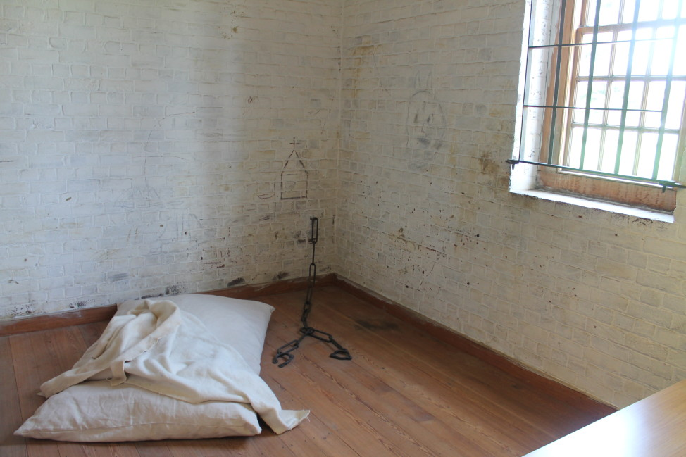 Recreation of a 1773 patient cell at the Public Hospital for Persons of Insane and Disordered Minds in Williamsburg,Virginia. Barred windows, board-and-batten doors, and chains fixed to the walls prevented patient escapes.