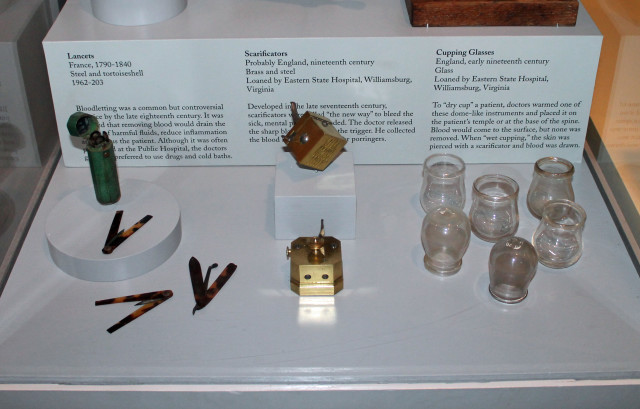 "The lancers (left) were used to bleed the patient to ""remove harmful fluids"". Scarificators (center) were bloodletting tools with a spring-loaded mechanism that snapped the blades out through slits to pierce the skin. With cupping (right), doctors pressed the warmed glass against the patient's skin to bring blood to the surface, although it wasn't removed."