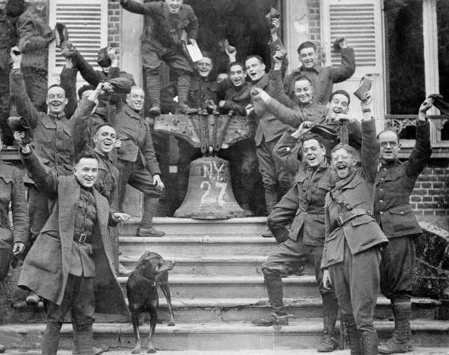 New York troops in Corbie, France, celebrate the signing of the Armistice Treaty, Nov. 11, 1918.  (AP Photo)