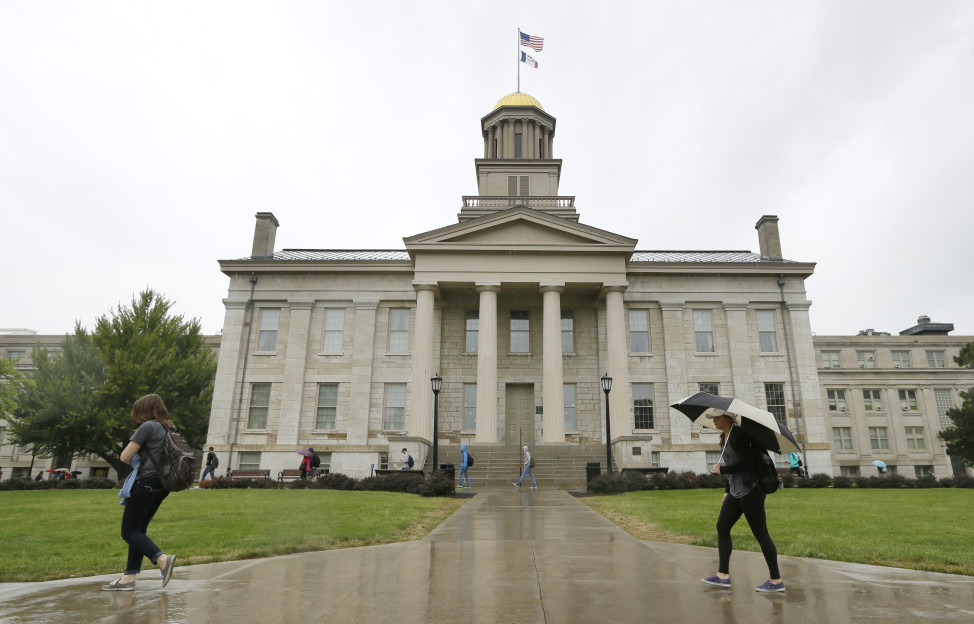 In this Oct. 2, 2014 file photo, students walk across campus at the University of Iowa in Iowa City, Iowa. (AP Photo)