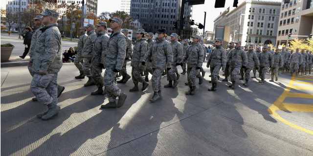 Military service veterans march in the Pittsburgh Veterans Day parade on Nov. 8, 2014, in Pittsburgh.