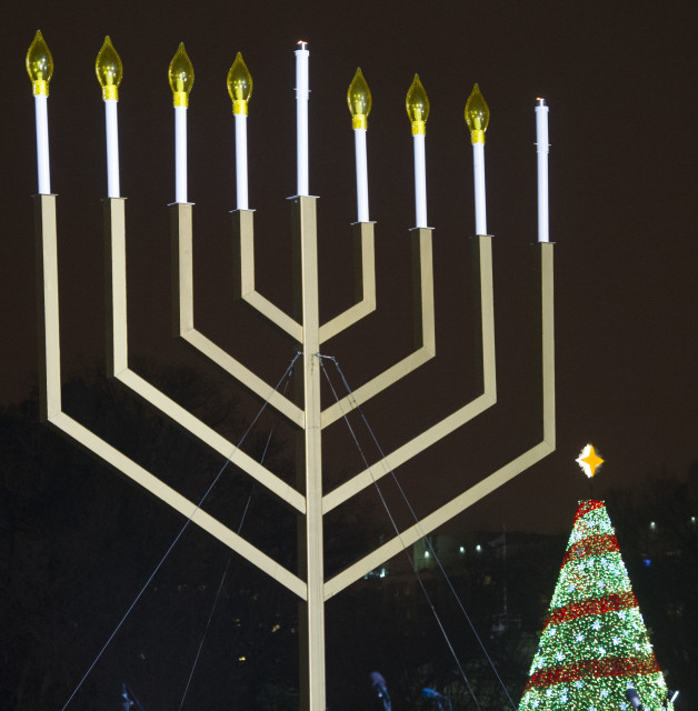 The National Christmas tree seen behind the National Menorah, on the Ellipse near the White House in Washington, Dec. 16, 2014. (AP)