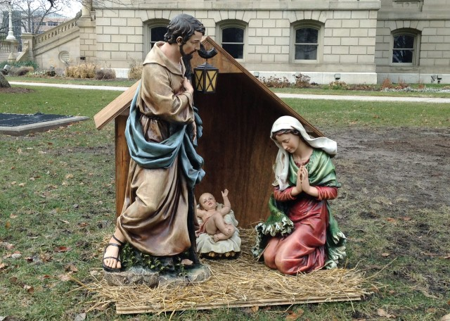 A nativity scene is displayed on the State House grounds in Lansing, Michigan, Dec. 19, 2014, two days before Satanists erected a competing display. (AP Photo)