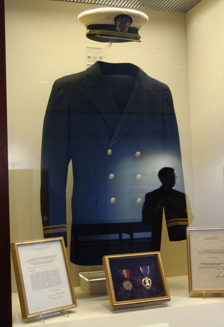 "Lt. John F. Kennedy's US Navy uniform on display, May 19, 2005, during the ""JFK in World War II"" exhibit at the John F. Kennedy Presidential Library and Museum in Boston. (AP Photo)"