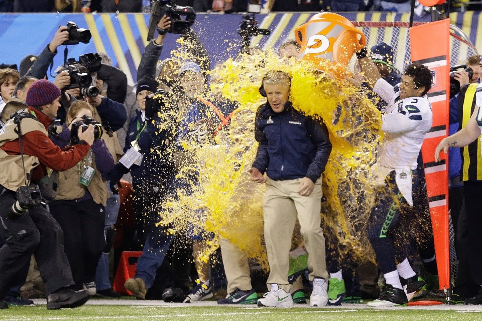 Seattle Seahawks head coach Pete Carroll is doused with Gatorade late in the second half of the NFL Super Bowl XLVIII football game  Feb. 2, 2014, in East Rutherford, New Jersey, once it was apparent his team was about to win the championship game. (AP Photo)