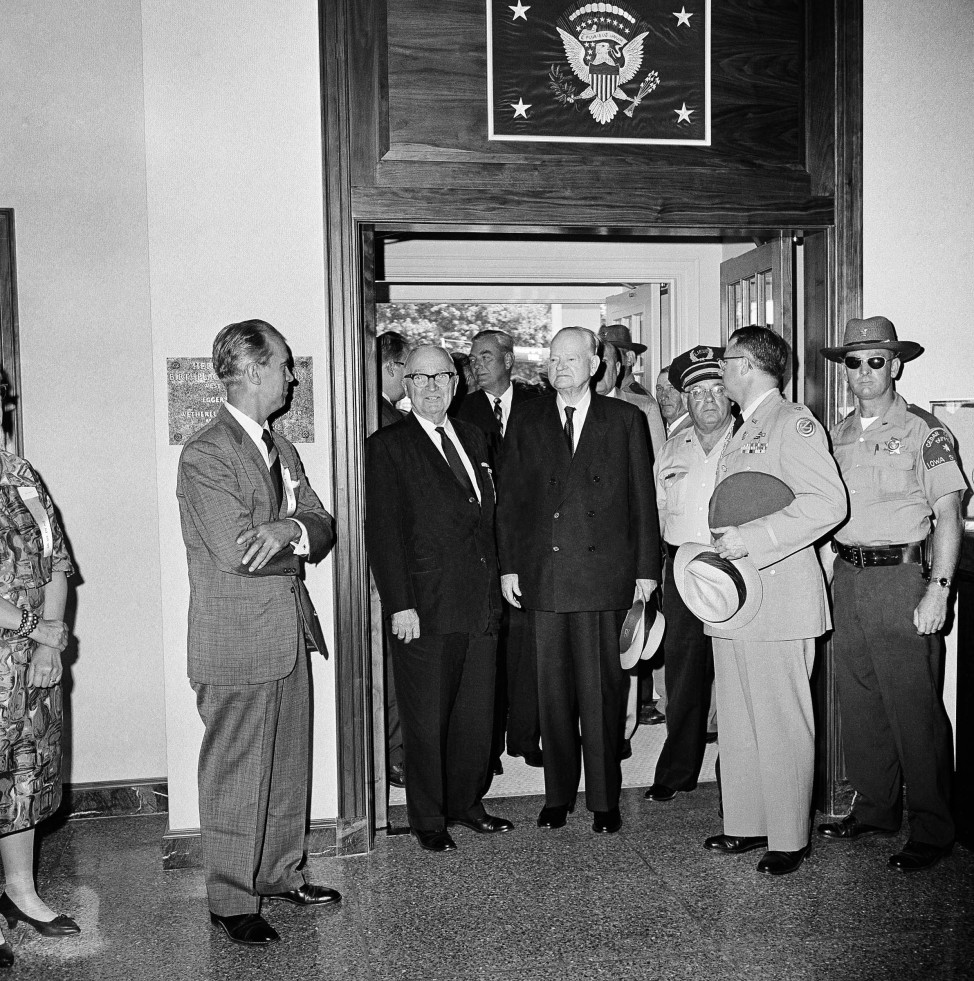 Former Presidents Herbert Hoover, right, and Harry Truman walk through doorway of the Herbert Hoover Presidential Library at West Branch, Iowa on August 10, 1962. The two took a short tour of the library during dedication ceremonies in Hoover's birthplace on his 88th birthday. (AP Photo)