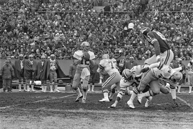 Dallas Cowboys quarterback Roger Staubach (12), seen here in the December 1975, says he recited a prayer before throwing the game winning touchdown. (AP)