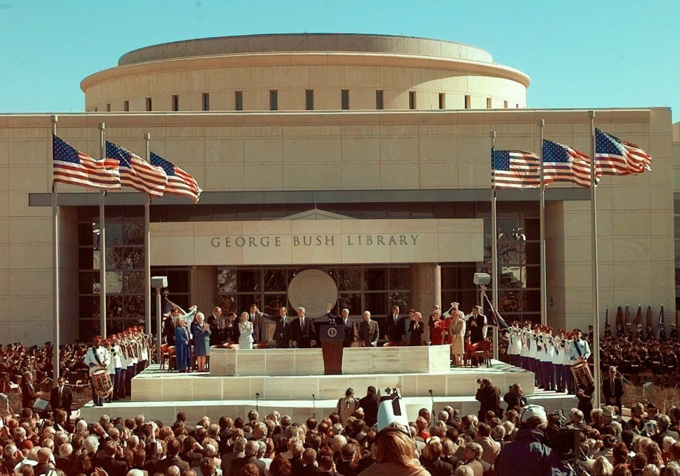 Former President George H.W. Bush, left, is joined by then President Clinton, former President Ford and former President Carter on the stage at the George H.W. Bush Presidential Library dedication in College Station, Texas, Nov. 6, 1997. (AP Photo)