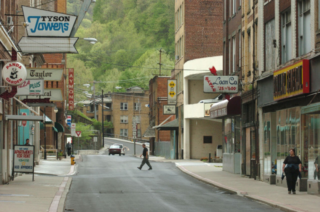 (File) People walk down McDowell Street in Welch, West Virginia. (AP Photo)