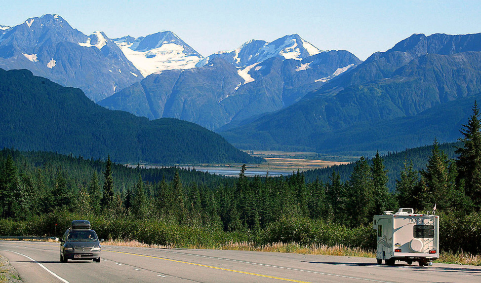 (File) Vehicles drive through Turnagain Pass on the Kenai Peninsula in Alaska, which a poll found is America's happiest state. (AP Photo)