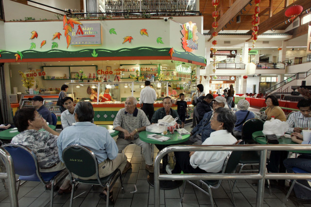 FILE -- People gather at the Asian Garden mall in little Saigon in Westminster, In Orange County, California. (AP Photo)