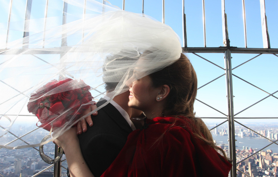 A couple shares a moment atop the Empire State Building after being married on Valentine's Day. (AP Photo)
