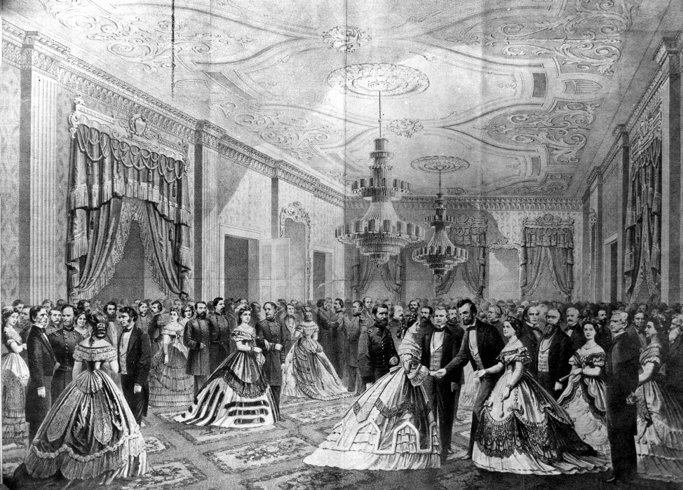 President Abraham Lincoln, right, receiving guests at his first reception in the East Room of the White House in Washington, D.C. in 1861.  (AP Photo)
