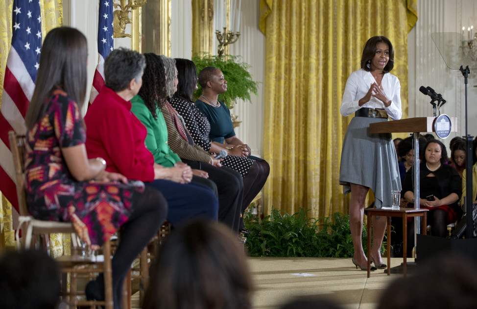 First lady Michelle Obama, right, speaks at the White House in Washington, Feb. 20, 2015, during an event commemorating Black History Month. (AP Photo)