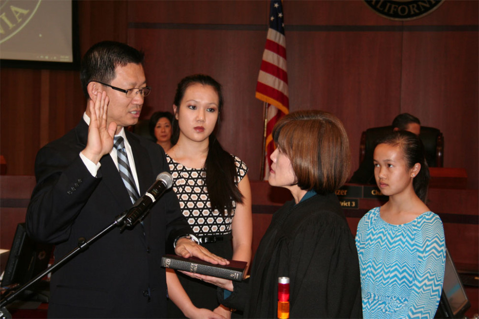 Andrew Do is sworn-in as supervisor of the 1st District of Orange County, California, by his wife, Judge Cheri Pham, Feb. 3, 2015.