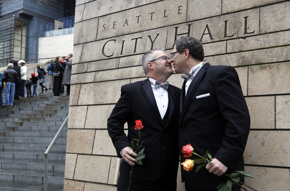 Terry Gilbert, left, kisses his husband Paul Beppler after wedding at Seattle City Hall, becoming among the first gay couples to legally wed in the state, Dec. 9, 2012, in Seattle, Washington. (AP Photo)