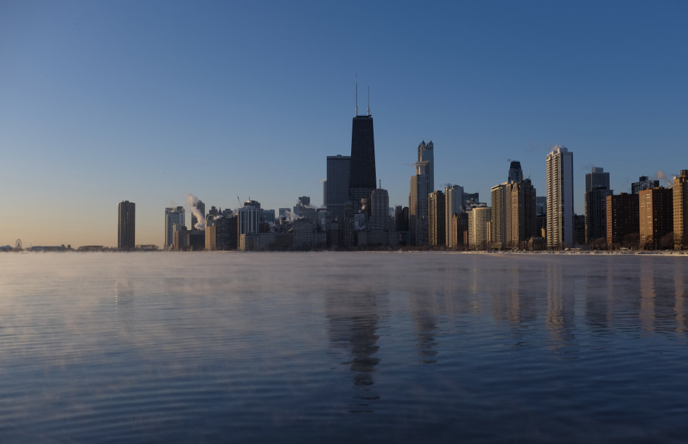 The sun rises on Lake Michigan in Chicago, Illinois. (AP Photo)
