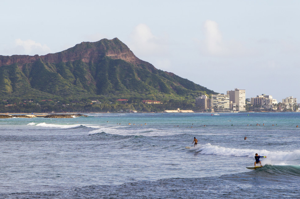 With Diamond Head mountain in the background, surfers hit the waves off Ala Moana Beach Park, in Honolulu, Hawaii.  (AP Photo)