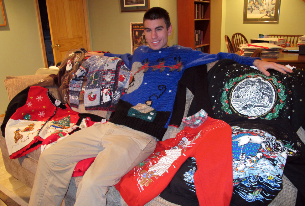 FILE – A young man poses with some sweaters in Wauwatosa, Wisconsin. (AP Photo)