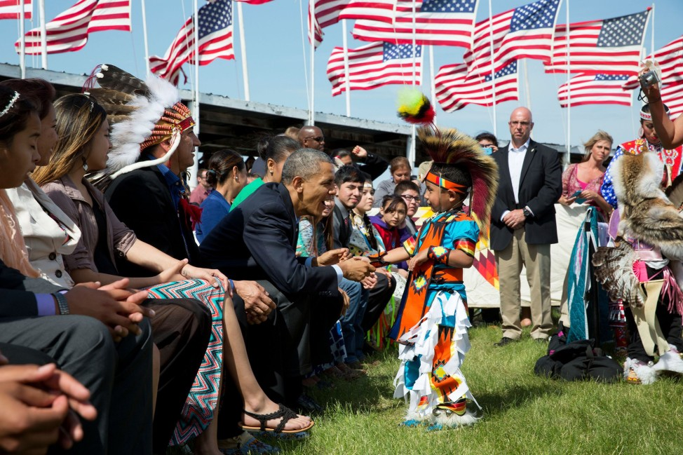 North Dakota, June 13, 2014. Greeting a young boy during a Flag Day celebration at the Standing Rock Sioux Tribe Reservation in Cannon Ball. (Official White House Photo by Pete Souza)