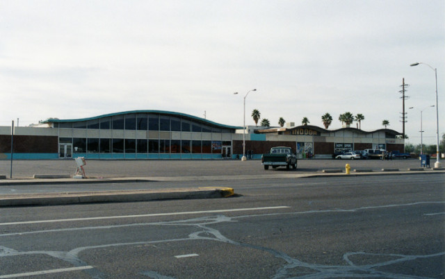A dying suburban shopping center in Mesa, Arizona.  (Photo by Flickr user  Roadsidepictures under Creative Commons License)
