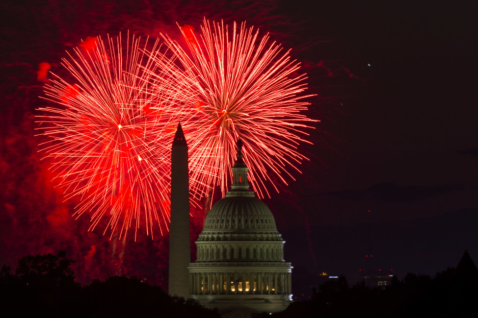 Fireworks illuminate the sky over the U.S. Capitol building and the Washington Monument during Fourth of July celebrations, on July 4, 2014, in Washington. (AP Photo)