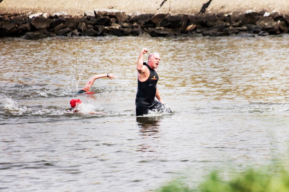 The author is triumphant after finishing the Chesapeake Bay swim challenge in 2013. (Photo by Andrew Weeks)