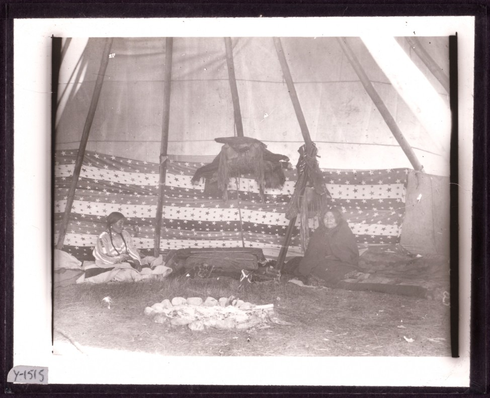An original, unpainted image of two women inside a tipi.  photographer Walter McClintock (1870-1949) of the Blackfoot Indians of Montana. (Yale Collection of Western Americana, Beinecke Rare Book and Manuscript Library)
