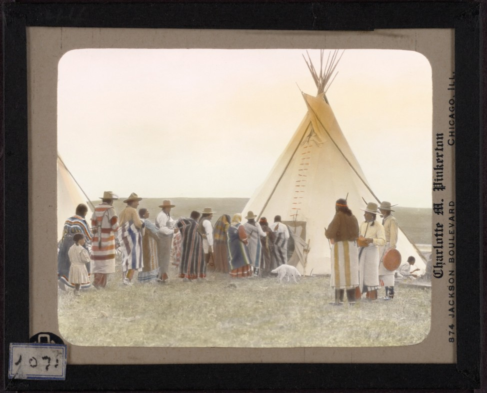 "White Grass entering his tipi at the end of the ceremony of the Dancing Pipe, from  the lecture, ""Dances of the Blackfoot"" given in 1936.  Hand-painted lantern slide by photographer Walter McClintock (1870-1949) of the Blackfoot Indians of Montana. (Yale Collection of Western Americana, Beinecke Rare Book and Manuscript Library)"