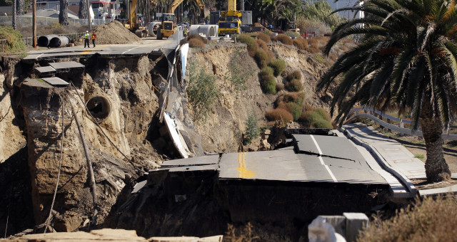 A section of a coastal bluff road collapsed in a heavy rainstorm in 2011's White Point landslide in San Pedro, California. (AP Photo)