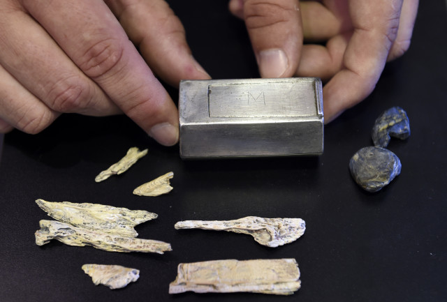 The small silver box, Jamestown researchers identify as a Roman Catholic reliquary, was found with the remains of prominent Jamestown leader Capt. Gabriel Archer. (AP Photo)