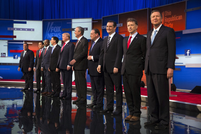 Republican presidential candidates from left, Chris Christie, Marco Rubio, Ben Carson, Scott Walker, Donald Trump, Jeb Bush, Mike Huckabee, Ted Cruz, Rand Paul, and John Kasich take the stage for the first Republican presidential debate, Aug. 6, 2015, in Cleveland, Ohio. (AP Photo)
