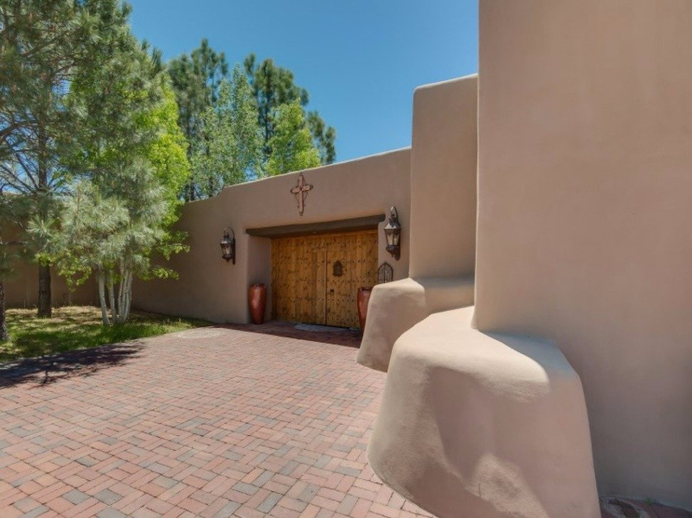 This 5-bedroom, 19,339-square-foot home in New Mexico, designed in the traditional Pueblo Revival style, costs $13.9 million. (Courtesy Sothey's International Realty)