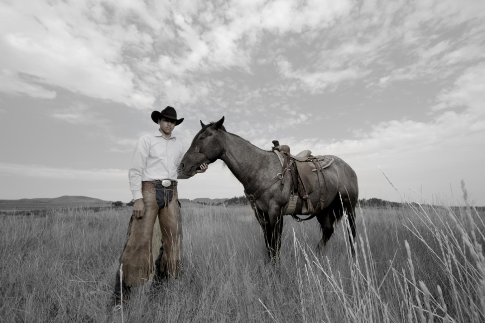 Industrial engineering student, Stephen Yellowtail, of the Crow Nation, at his family's cattle ranch in Montana. (Photo by Matika Wilbur)