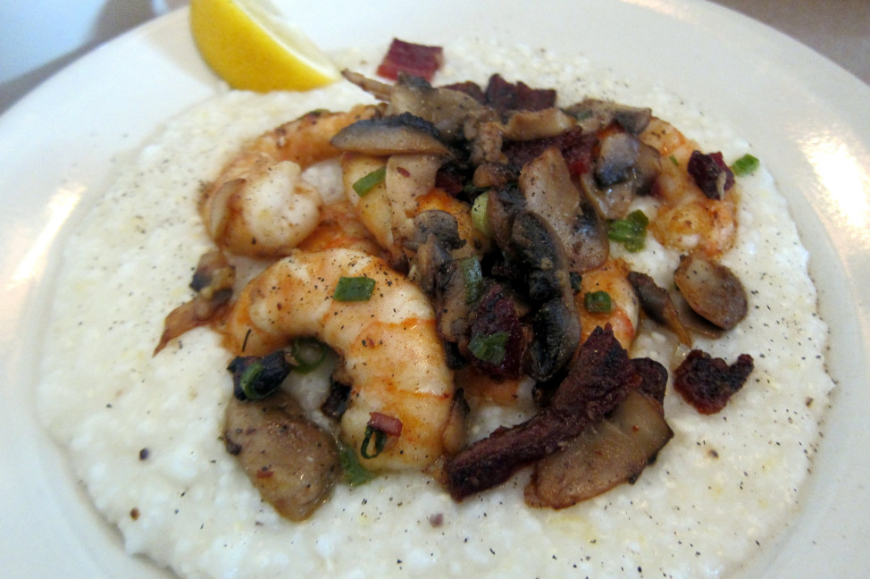 Shrimp and grits  with scallions, mushrooms and bacon over cheese grits, served at the Hominy Grill in Charleston, South Carolina. (Photo by Flickr user Wally Gobetz via Creative Commons license)