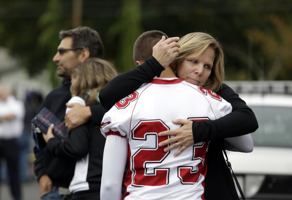 Students and family members reunite at Shoultes Gospel Hall after a student opened fire at Marysville-Pilchuck High School, in Marysville, Washington October 24, 2014. (Reuters)