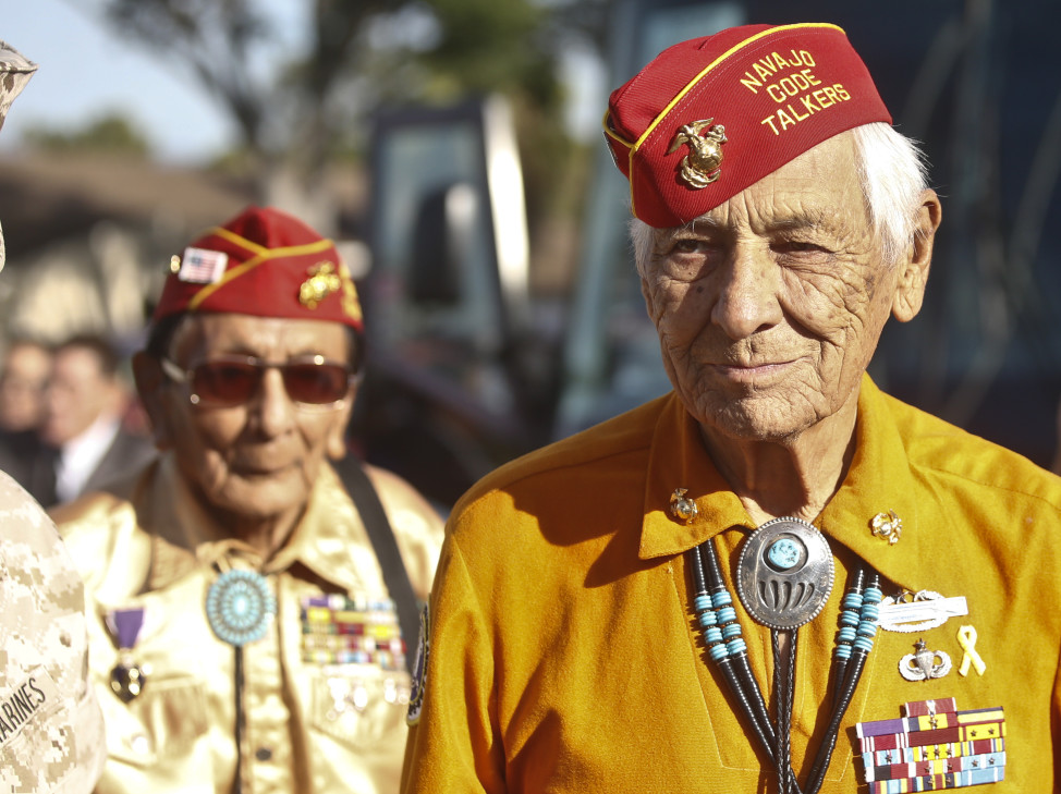 Former United States Marine and Navajo Code Talker Roy Hawthorne, right, leads fellow Marine and Navajo Code Talker Sam Holiday at a ceremony honoring the Navajo contribution to the World War II, Sept. 28, 2015, at Camp Pendleton, Calif.  (AP Photo)