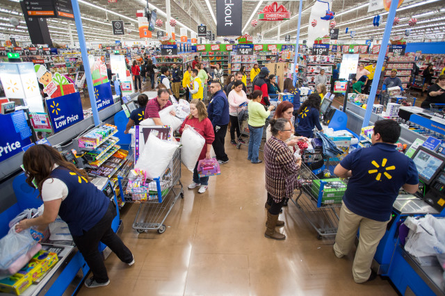 Cashiers at work at Walmart. About 3.4 million Americans work as cashiers. (AP Photo)