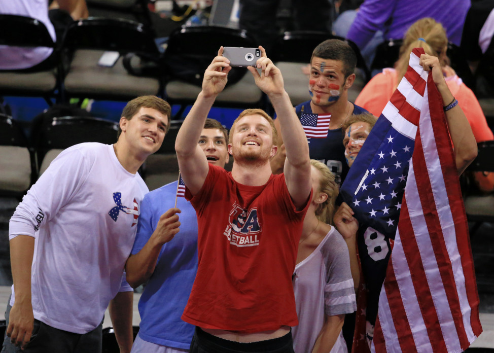 Americans take a group selfie before a volleyball match between the United State and Italy, July 23, 2015. (AP Photo)