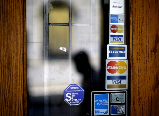 On average, Americans carry $15,000 in credit card debt. (AP File Photo)